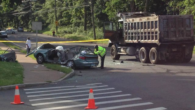 A car and a dump truck were involved in a crash on Monday. (WFSB photo)