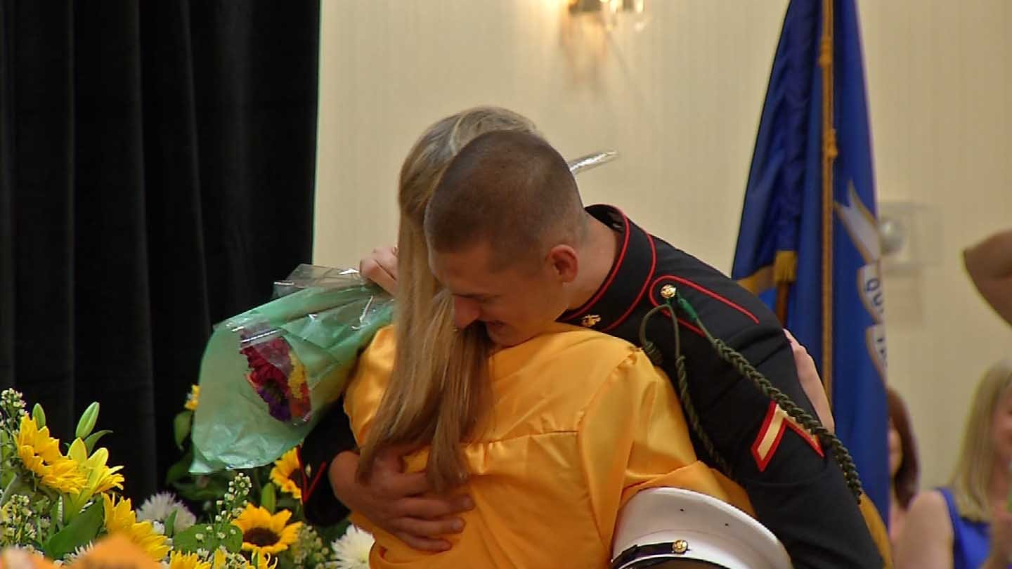 Pfc. Marine Robert Bayer surprised graduate Margaret Karwowski Wednesday night. (WFSB photo)