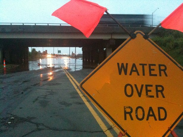 Sign warns of high water along Route 10 in New Haven.