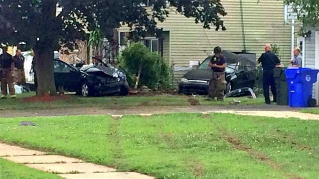 Car crashes into home on High Street in East Hartford (WFSB Photo)