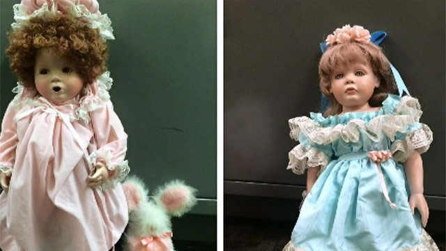 Two of the dolls left at neighbors' homes. (CBS photo)