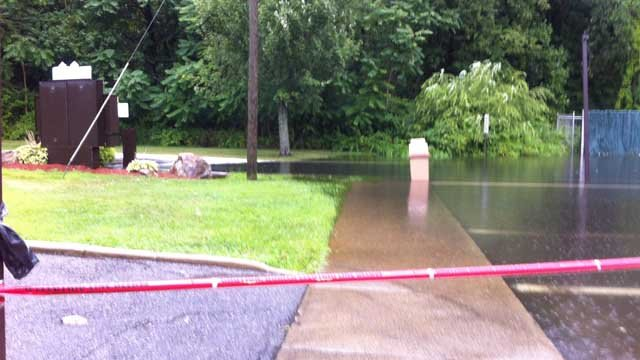 Flooding closed a Dunkin' Donuts drive-thru on Route 1 in Branford. (WFSB photo)