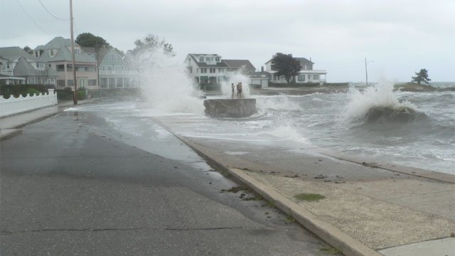 The water came over the road at Anchor Beach in Milford. (iWitness photo)