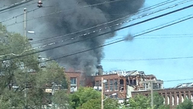 Firefighters are battling a fire at the vacant Remington Factory building in Bridgeport on Tuesday morning. (iWitness Photo)