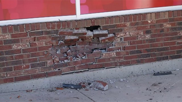 A car damaged CVS, which is located at 2427 Main St., after crashing into the building on Friday morning. (WFSB photo)