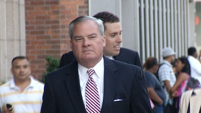 Former Gov. John Rowland walking into federal court in New Haven on Wednesday. (WFSB photo)