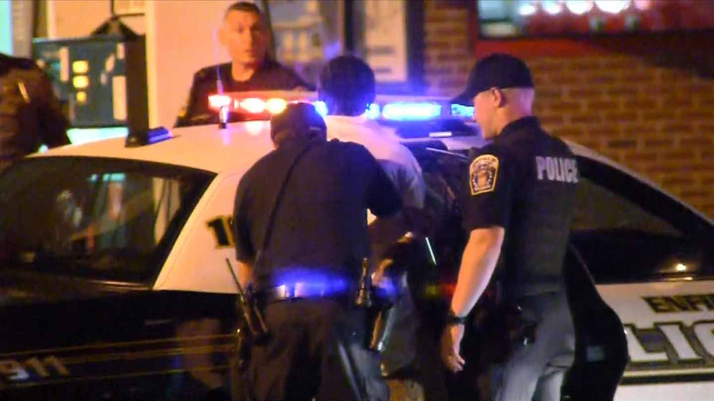 Eyewitness News cameras were rolling when two people were cuffed and hauled away in a cruiser. (WFSB photo)