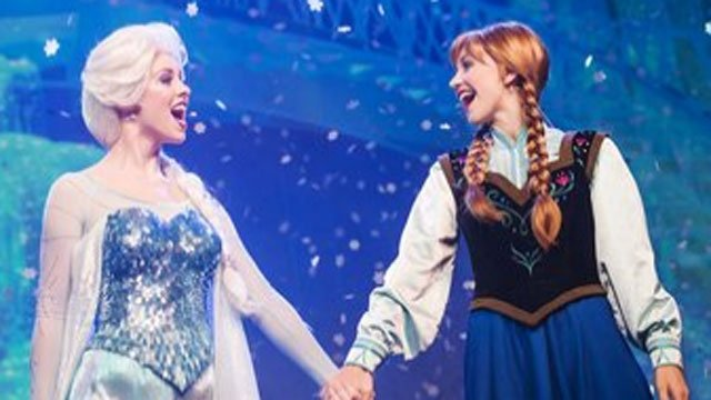 "Royal sisters Princess Anna and Queen Elsa, from Disney's hit animated motion picture ""Frozen,"" join the Royal Historians of Arendelle for a fun and comedic storytelling and sing-along during ""Frozen Summer Fun LIVE!"" (From Walt Disney World)"