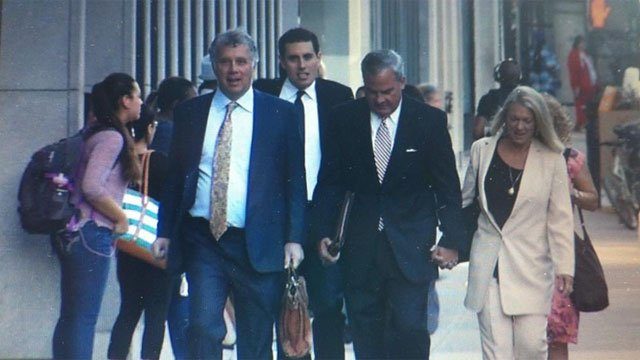 Former Connecticut Gov. John Rowland walks into New Haven Federal Court on Monday with his lawyer and wife, Patty. (WFSB photo)