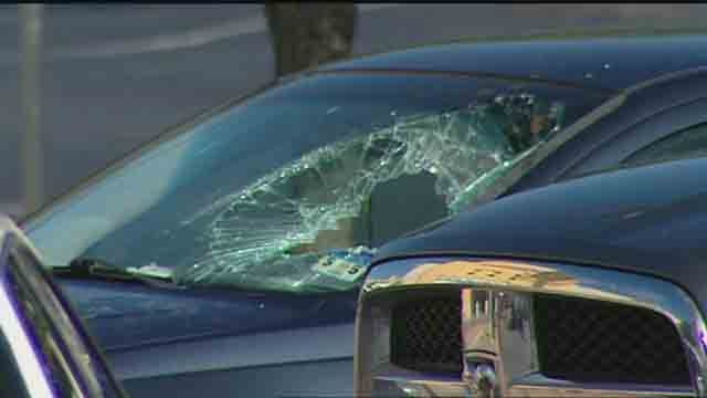 Woman breaks window to save child from hot car (CNN)