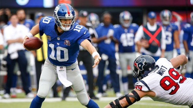 New York Giants quarterback Eli Manning (10) tries to avoid Houston Texans defensive end J.J. Watt (99) in the first quarter of an NFL football game, Sunday, Sept. 21, 2014, in East Rutherford, N.J. (AP Photo/Kathy Willens)