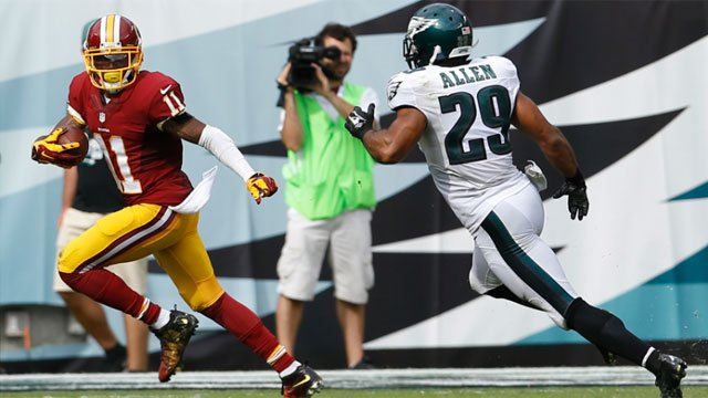 Washington Redskins wide receiver DeSean Jackson (11) looks back as Philadelphia Eagles strong safety Nate Allen (29) chases after him on a scoring reception during the second half of an NFL football game, Sunday, Sept. 21, 2014, in Philadelphia. AP Photo