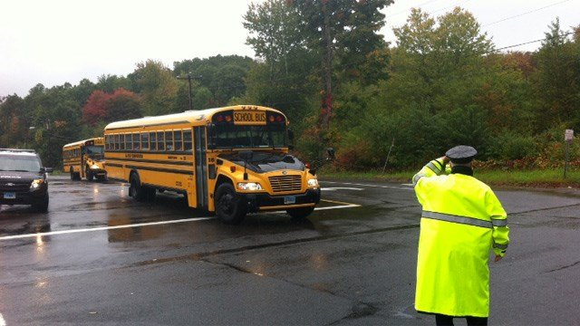 Students from Sandy Hook Elementary School in Monroe are being bused home after police said a threat was called into the school.