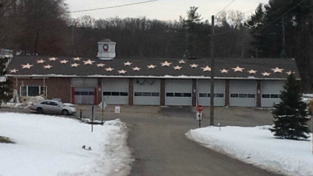 20 small and 6 large bronze stars are displayed on the roof of Newtown's firehouse.