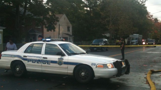 Police remain on scene after one firefighter dies while fighting a fire in Hartford on Tuesday night.