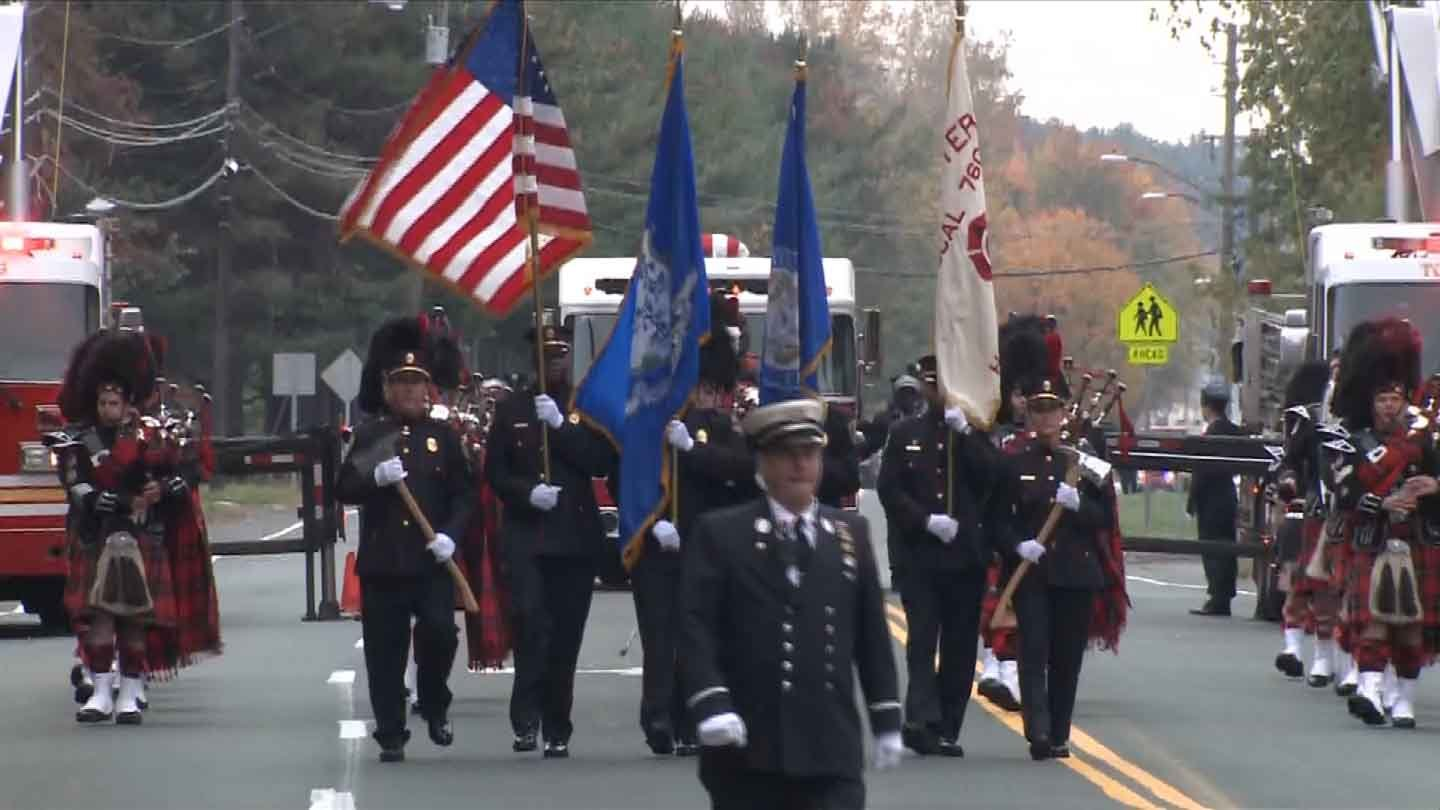 The funeral procession for firefighter Kevin Bell.
