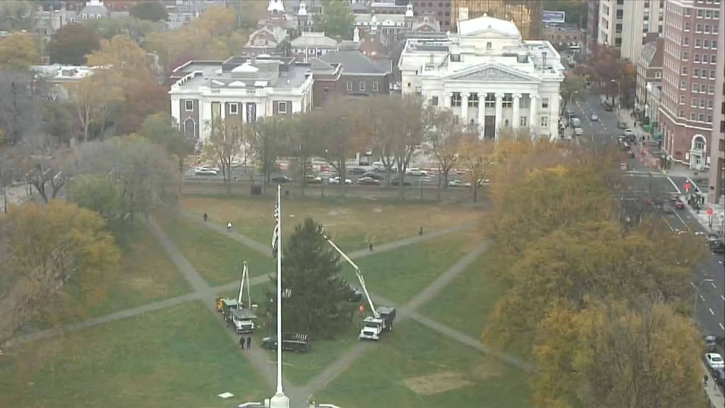 Crews strung up holiday lights on New Haven's green last month. (WFSB photo)