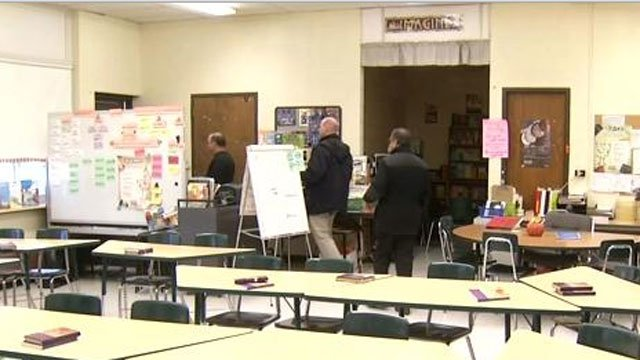 Police, architects, engineers and school officials toured Naugatuck schools on Thursday.