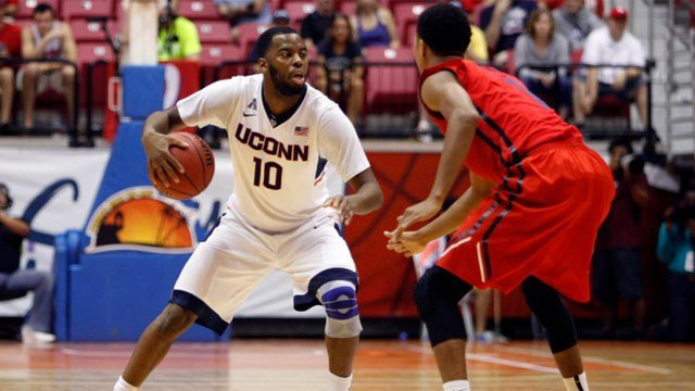 UConn guard Sam Cassell Jr., left, controls the ball under pressure from Dayton guard Darrell Davis during a NCAA college basketball game in San Juan, Puerto Rico, Friday, Nov. 21, 2014. (AP Photo/Ricardo Arduengo)