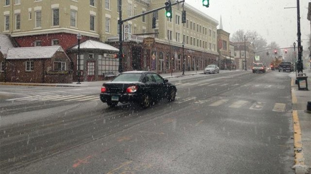There are snow covered roads in downtown Torrington and plows are out.