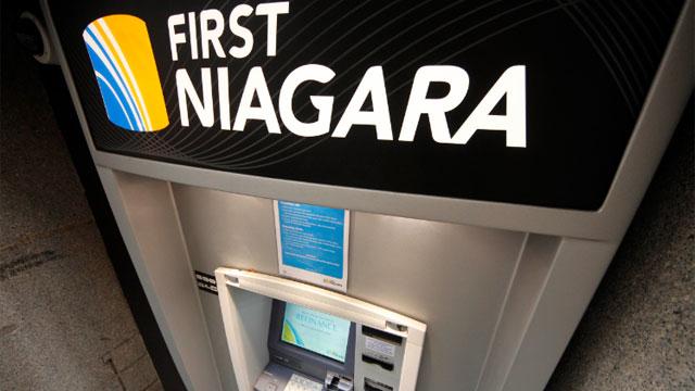 This Jan. 12, 2012 photo, shows a First Niagara Bank ATM machine in downtown Pittsburgh.  (AP Photo/Gene J. Puskar)