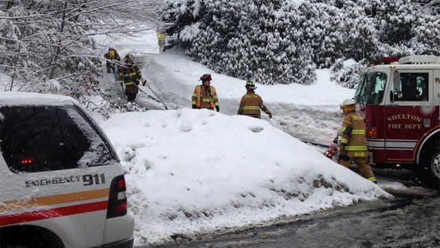 Shelton firefighters were forced to dig out hydrants in 2015. (WFSB file)