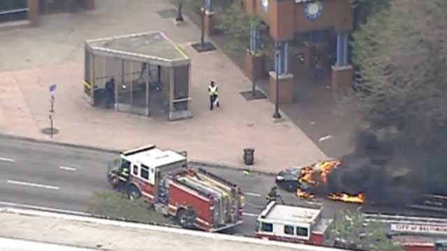 Police car on fire in Baltimore (CBS News)