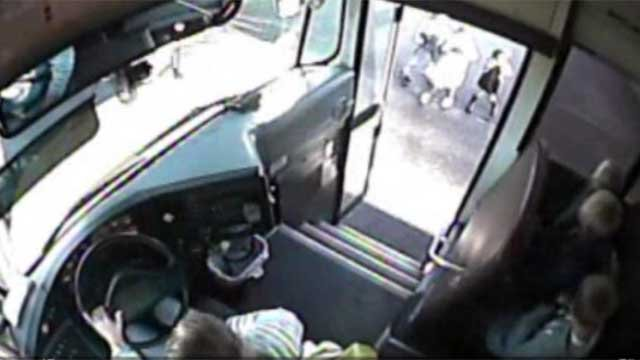 SUV nearly hits students boarding school bus (CNN)