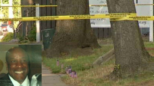 Pastor Augustus Seely was shot as he was setting up this flag display in Hartford, police said. (Family/WFSB photos)