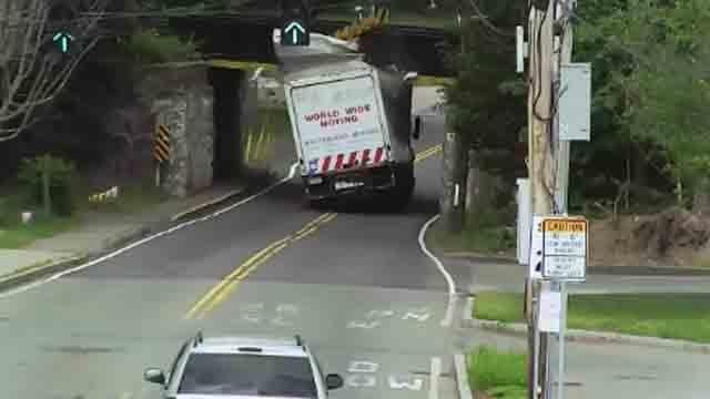 Too tall box truck hits railroad bridge (CBS News)