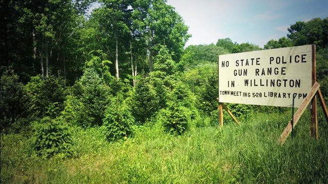 Signs up were posted all over Willington opposing moving the CT State Police firing range to town. (WFSB)
