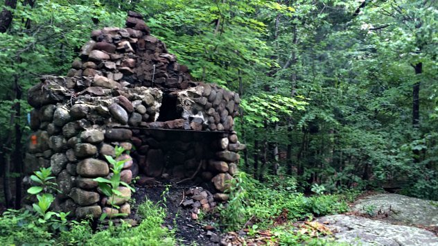 Stone fireplace along the trail