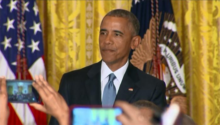 Obama has a battle of words with a heckler at an LGBT Pride Month event. (Source: CNN)