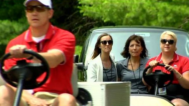 Volunteers help patrons at the Travelers Championship on Thursday. (WFSB)