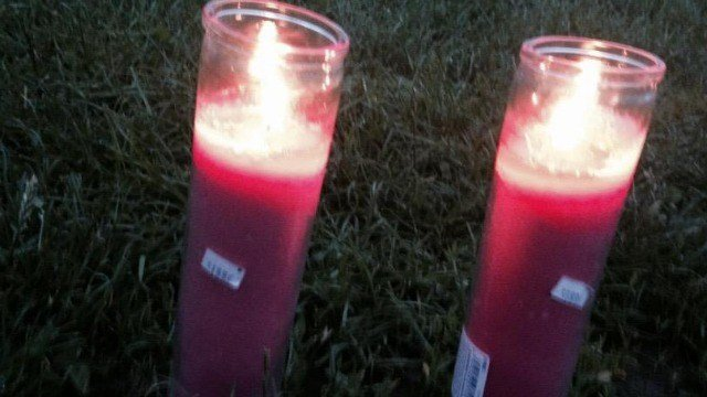 Two candles were lit left outside of court where the tournament was held will be joined by others later on Tuesday. Vigil at 6 p.m.near Rawson elementary School (WFSB)