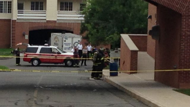 Firefighters are checking a barrel with two chemicals inside it. (WFSB)