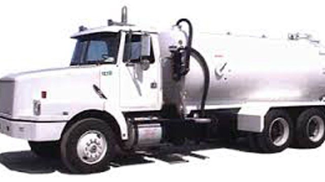 Police say a pump truck like this one may be dumping grease into Orange's sewer system. (Orange police photo)