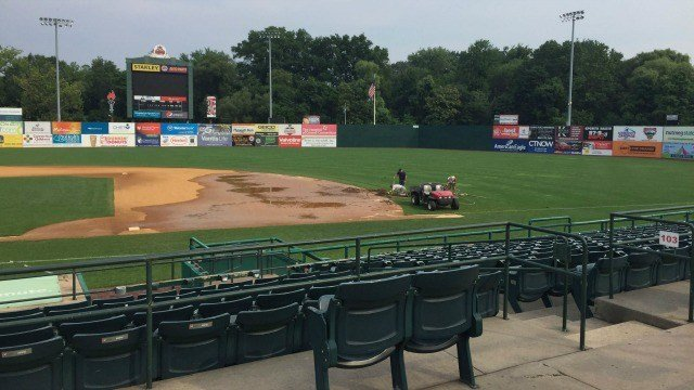 Crews are working on the field at the New Britain Rock Cats stadium after a break in the field irrigation system. (The New Britain Rock Cats)
