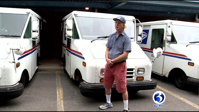 Paul Horton received received the National Hero Award from the postmaster general of the United States Postal Service on Monday. (WFSB)