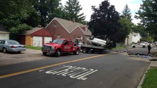 Crews respond to rollover crash in New Haven on Tuesday morning. (WFSB)