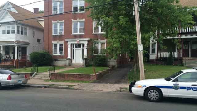 Police investigate at a home on Elmer Street after reports of critical injuries to a 1-year-old (WFSB)