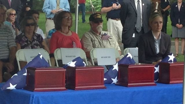 Flags and urns represent the remains of four unidentified veterans. (WFSB)