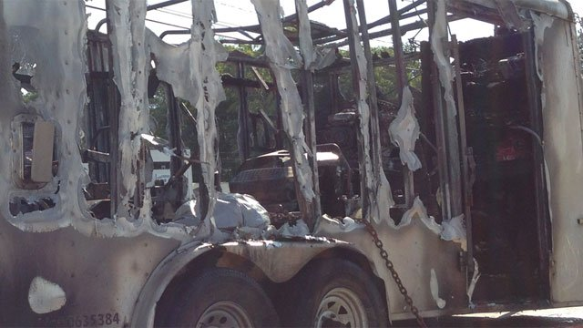 A trailer sustains heavy damage after fire. (WFSB)