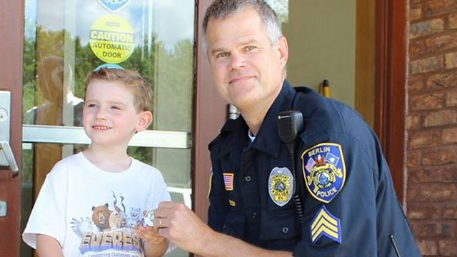 Henry Nowik,5, is given the BPD Community Officer Investment Network Coin by Sgt. Mark Soneson. (Berlin Police Facebook page)