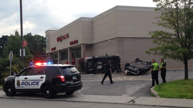 An unidentified teenager was hospitalized following this Torrington rollover. (WFSB photo)