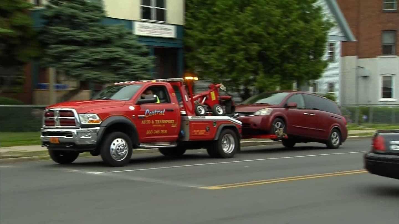 Crews hauled away a maroon van following the shooting death of a 47-year-old man on Sunday. (WFSB photo)