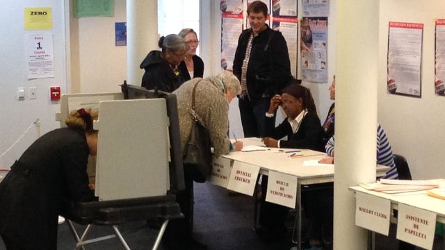 Voters cast ballots at the Hartford Seminary, where election officials were writing down names. (WFSB file photo)