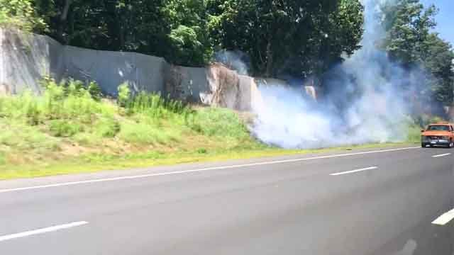 Crews battled a brush fire on the side of I-84 in Vernon on Monday afternoon. (iwitness)
