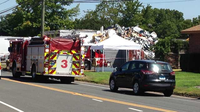 Manchester firefighters battled a fire at a scrap yard on Tuesday. (WFSB photo)