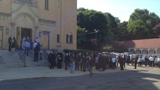 A line of mourners waited to pay respects to Loredana Nesci at Our Lady of Mount Carmel Church in Meriden. (WFSB photo)